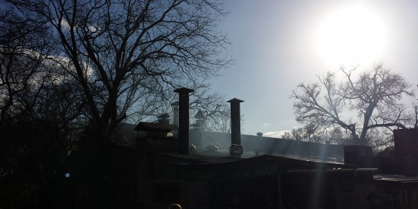 Smoke from the pit over the original Salt Lick building