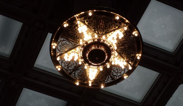 A dual fuel chandelier on the floor of the House of Representatives, Austin, TX