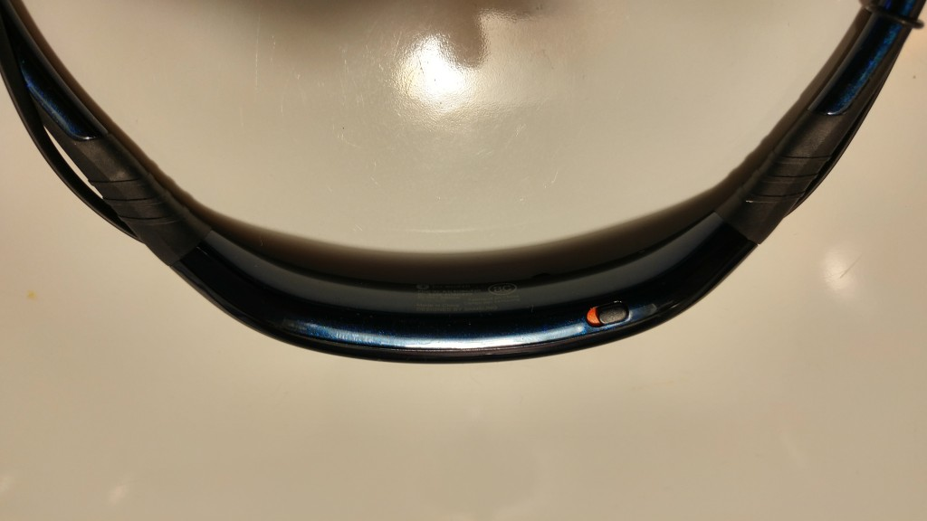 Location of the power button on the Samsung Level U stereo headphones.