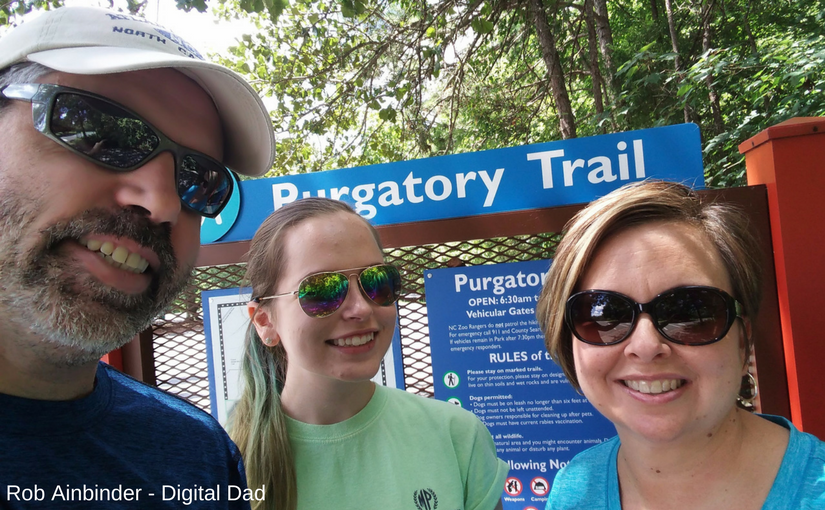 Picture of family in front of Purgatory Trail sign.